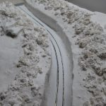 Tim's snow 1&2.jpg - Latest developments on Tim Williams' Show Scene, where the area to the sides of the 'cut' now show evidence of chaps working to clear the snow with shovels. (photo © Tim Williams)